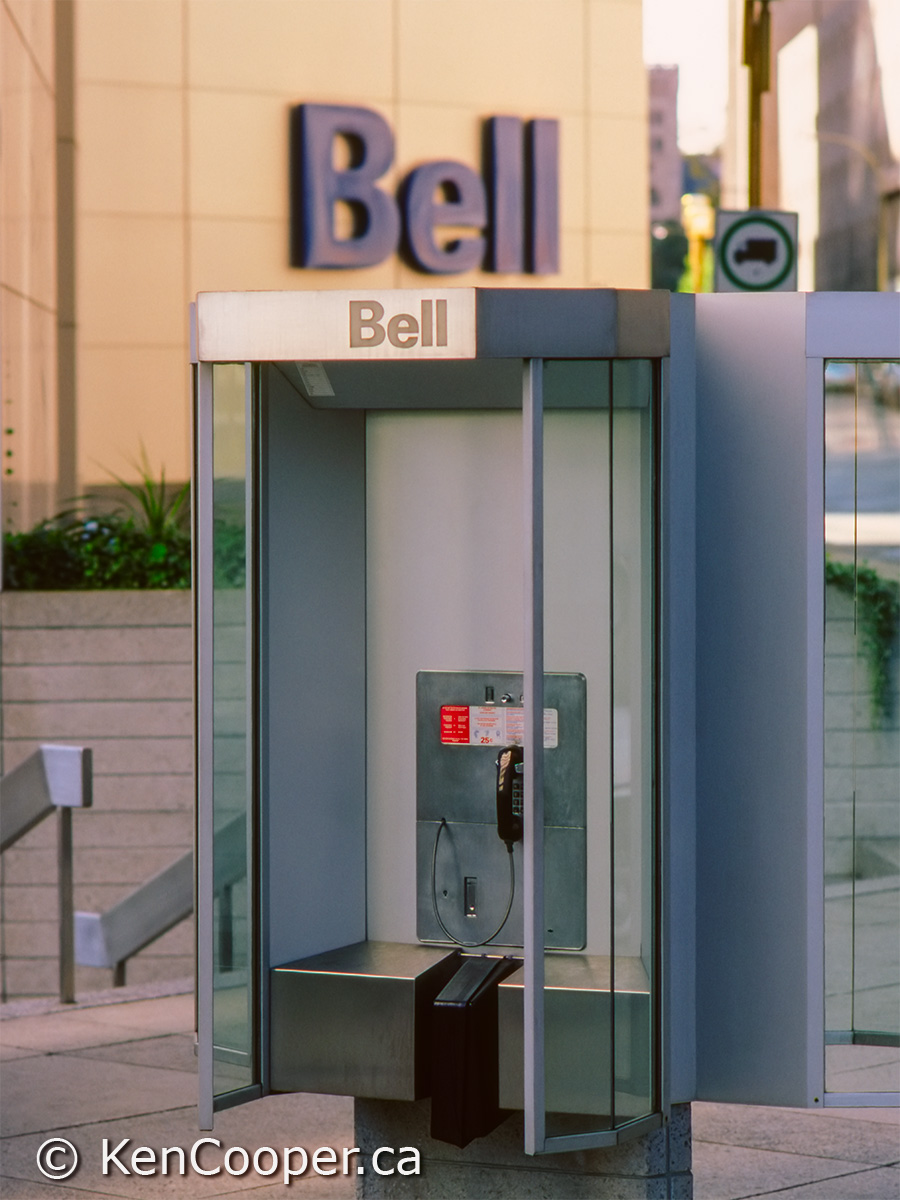 Bell pay telephone in front of Bell Tower - Montreal.