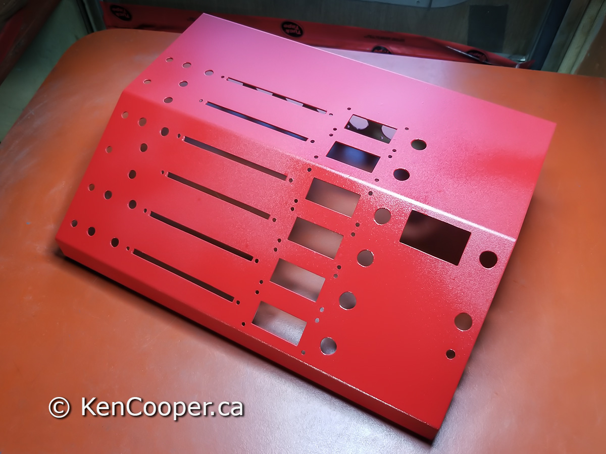 Apply first coat of red paint on console top.